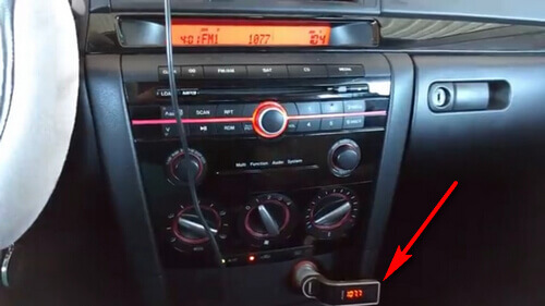 Plug the FM Transmitter to Car ciggrette socket